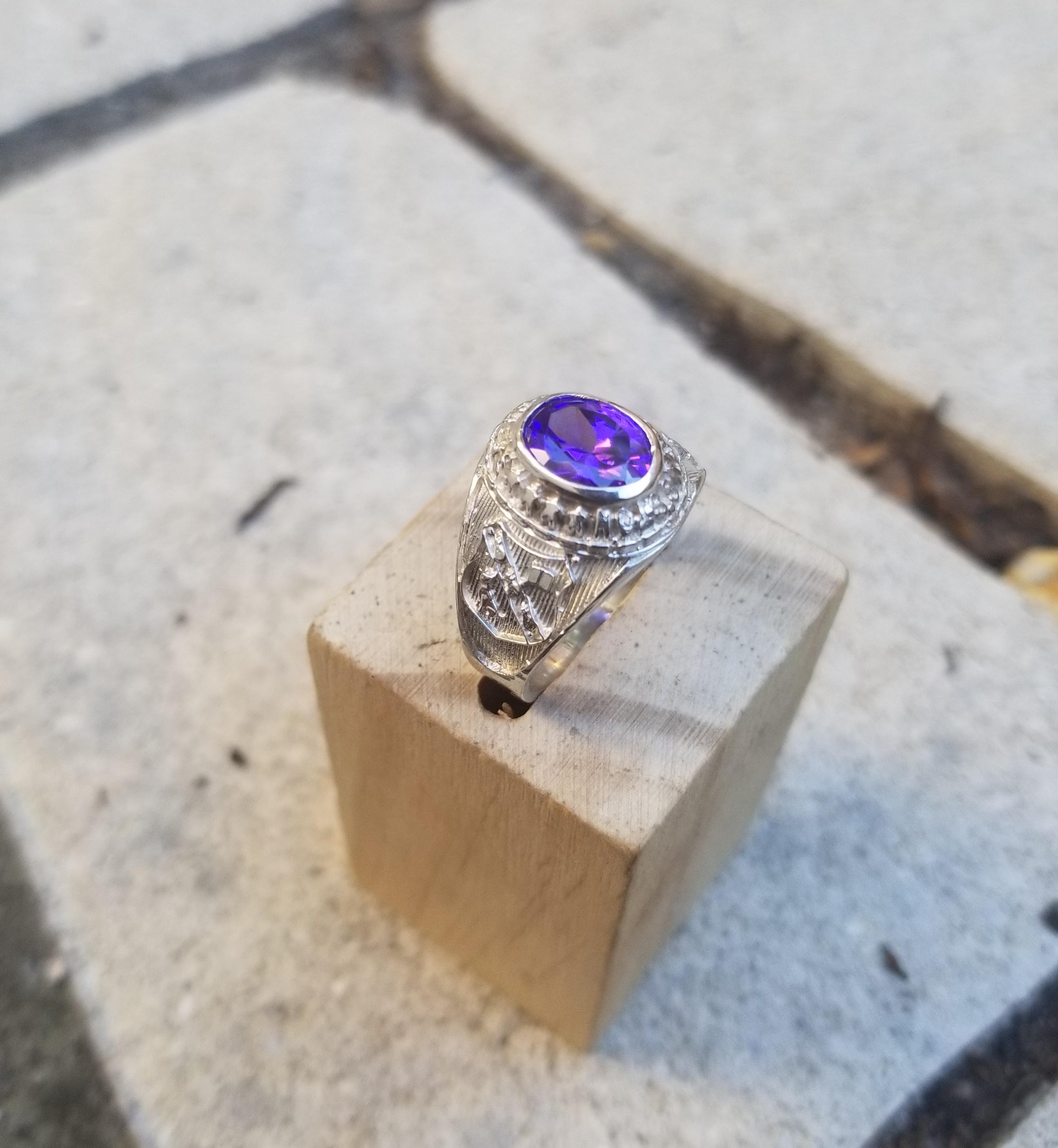 kingston college class graduation ring with purple stone